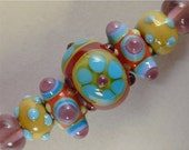 Set of 7 Handmade Art Glass Lampwork Beads, by Patti Cahill, sra -- Sum'r o' Luv floral focal