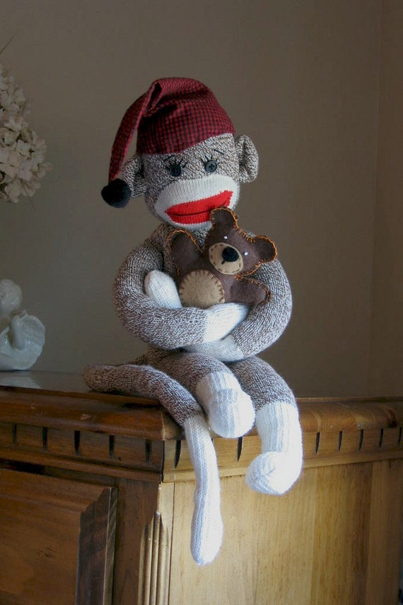 Sock Monkey plush holding Teddy bear stuffed toy