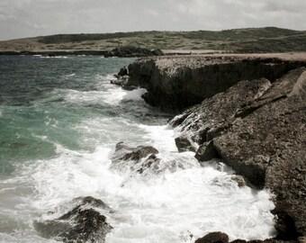 Photograph of the Crashing Waves Rugged Cliff Side Rocky Shoreline Coastline Cove of Caribbean Aruba Tropical Vertical Art Print Home Decor