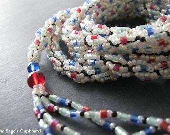 Art Deco Lariat. Handmade Beaded Spiral Stripe Necklace with Jewel Tone Tassels