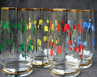Vintage glasses. Collection of four fun colors for your Spring table setting.