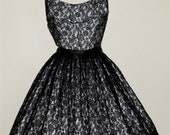 Vintage 1950's Mad Men black lace Cocktail Party Dress.LBD. New Look. Illusion Lace. Halter. Scalloped Bust. Rhinestones.  Satin.  Minx Mode
