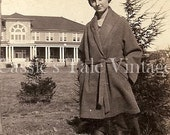Vintage Photo - Young Woman in Short Belted Coat, Black Stockings, & Loafers on Sidewalk in Front of Big House, c. 1910s-1920s