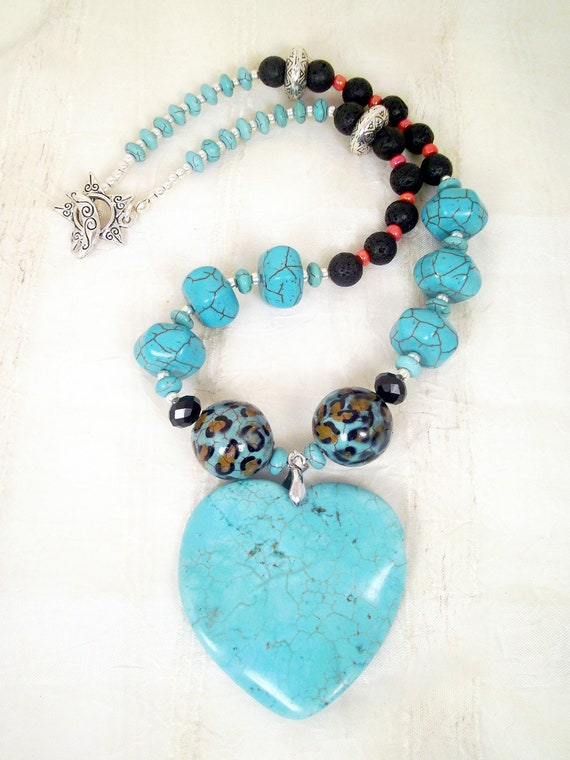 Turquoise howlite freeform heart, hexagon rondelles and spacers, leopard and black lava beads, coral, silver necklace set: Blue Leopard Love