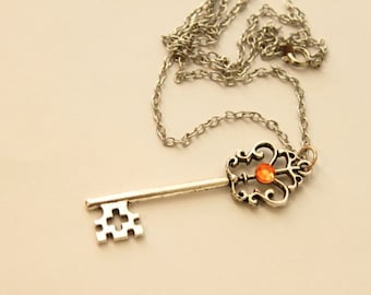 Simple Ornate Antiqued Pewter Tibetan Silver Victorian-Style Cross Design Key Necklace With Peach Gem