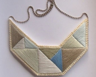 Geometric statement bib necklace hand embroidered silvery grays and blues Winter fashion