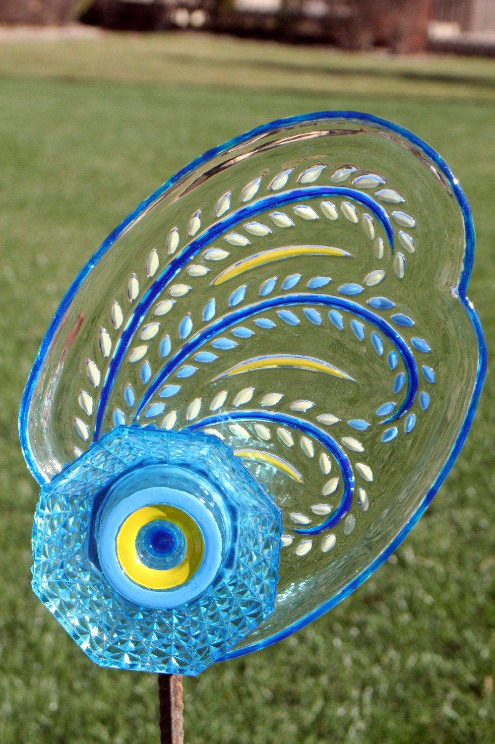 glass plate garden art and yard art with recycled glass on