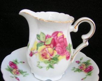 Creamer and Saucer with Flowers and Gold Trim Made in Japan