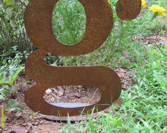 "13 Inch lowercase metal letter ""g"" on a stand"