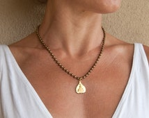 Gold Buddha  Necklace. Bestseller