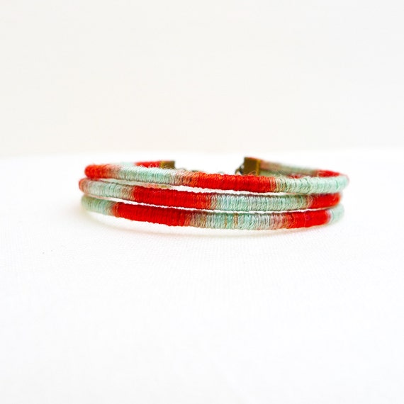 Multi strand cuff - wrapped with hand dyed red and mint cotton thread