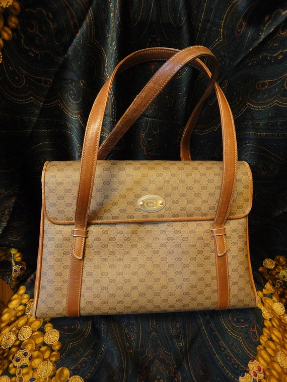 80's vintage Gucci beige and brown monogram purse. Nice vintage gucci tote that is good for work too. Unisex