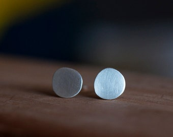 8mm organic round flat circle studs. Recycled sterling silver brushed matte satin finish. Modern minimalist everyday post earrings by Obliss
