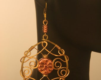 Brass Wire Filigree Earrings With Copper Colored Glass Beads.
