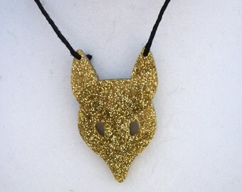 Gold fox necklace.