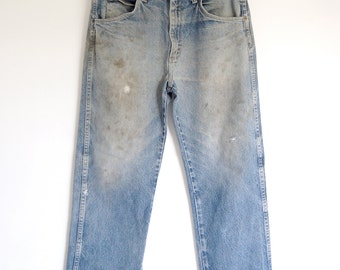 vintage mens destroyed blue jeans / faded grunge Wrangler patched work jeans / rivets distressed weathered / Made in USA / 33 x 30