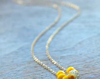 sunshine necklace (yellow faceted glass. vintage glitter Lucite disc. gold filled chain)