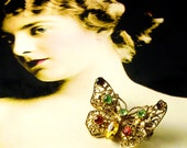 Vintage FILIGREE Rhinestone Butterfly Brooch. Gold tone w multicolored rhinestones. Ca. 1930's