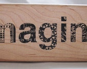 imagine in collaged letters rubber stamp