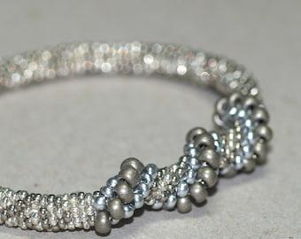 Silver Spiral ... Bangle Bracelet . Matte Silver . Shiny . Pewter . Stainless Steel . Bead Crochet . Spirals . Elegant . Handmade Jewellery