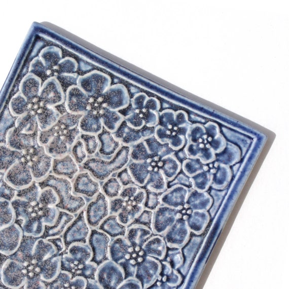 Apple Blossoms - Handmade Tile with embossed design glazed in slate blue matte for home decor.
