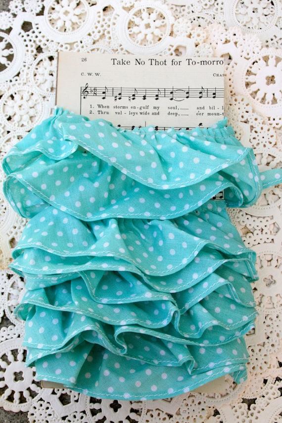 Mint green and white polka dot ruffled trim