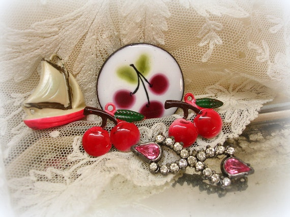 sWeet vintage cherry charms and findings . pot metal and rhineStone dress trim . enamel cherries . celluloid sailboat charm
