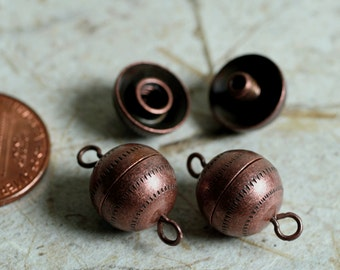 Clasp, barrel, antiqued copper, 11mm textured round with fancy design, 2 pairs (item ID F7480FX)