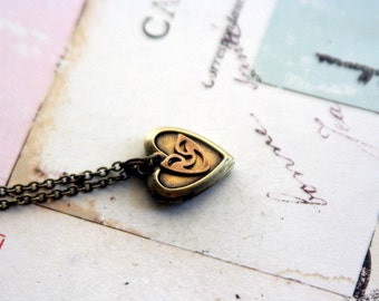comedy locket necklace. brass ox color