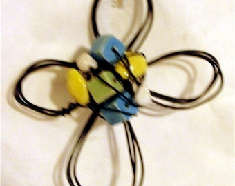 yellow, lime green, turquoise,  ceramic--  wire cross ornament