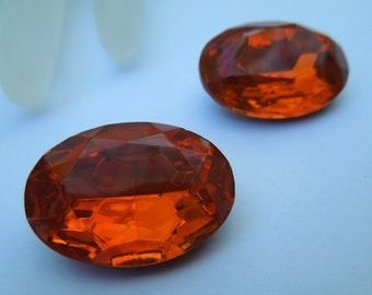 18x24mm Faceted Foiled Oval stone and it's ORANGE