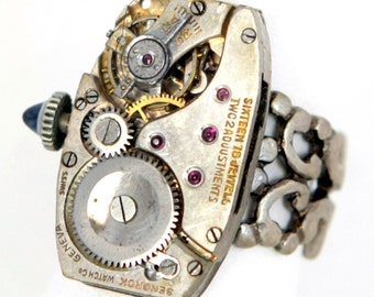 Steampunk Antiqued Silver Ring with Large Vintage Watch Movement and Winding Stem with Blue Crystal by Velvet Mechanism