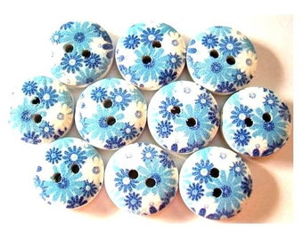 10 Wood buttons 15mm flower picture in blue shades on white surface