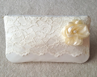 ivory lace wedding clutch with flower and pearl center