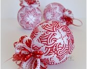 Candy cane peppermint swirl red and white quilt ball Christmas tree ornament