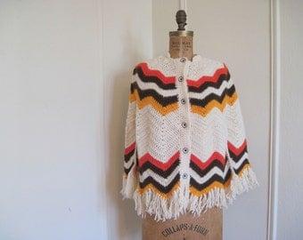 1970s Poncho - cream, vermilion, brown, and orange Chevron Stripes