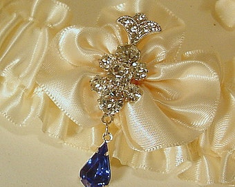 wedding garter UNE FLEUR CRISTALLINE with blue drop a Peterene original design Swarovski crystals