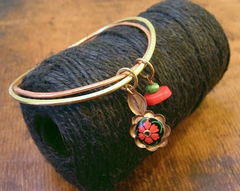 Folk art floral simple double bangle. Red, green, black, copper, brass.