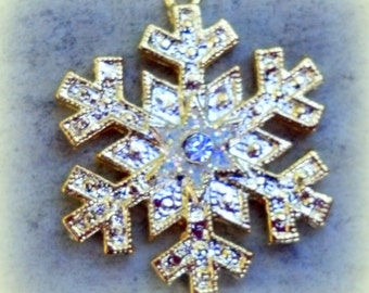 Snowflake Charm, 24K gold-finished with Swarovski clear crystal.