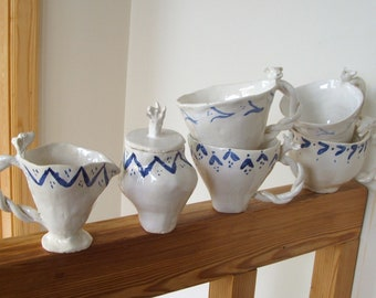 Unique Pottery 4 cups with cream and sugar  Cow Heads White with Blue