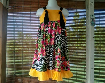 KNOT DRESS in yellow and multicolored fabric.