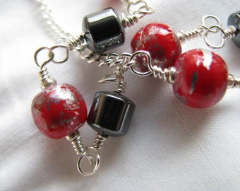 Red Swirl Glass and Hematite Necklace