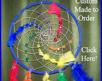 Order a custom made Dream Catcher by Shikoba Humma choose colors, feathers, charms,etc.