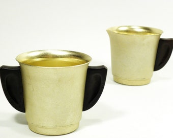 gold metal cream & sugar set . MIRRO the finest aluminum . great wing shape black celluloid handles . 1940s 1950s 1960s