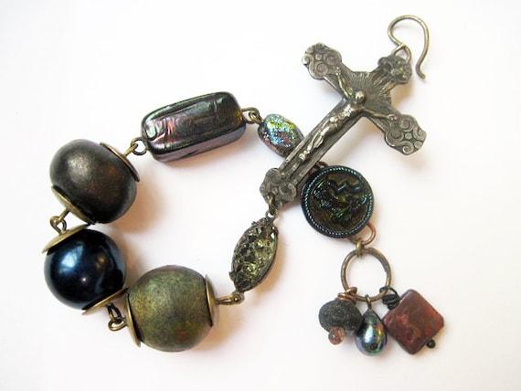 The Human Night. Cosmic Rustic Dark Assemblage Bracelet with Sterling Crucifix, Iridescents and Raku Art Beads.