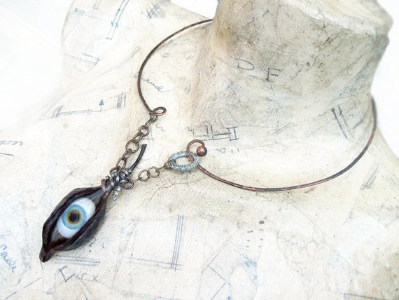Among Empty Eternities. Glass Eye in Natural Pod with Hammered Choker.
