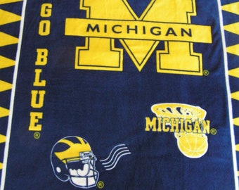 Quilted Double Layer U of M Fleece Blanket and Pillow