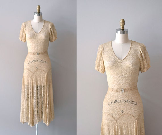 ecru silk lace vintage bridal dress with v-cut neckline and rhinestone belt