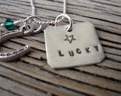 Lucky- sterling silver hand stamped pendant tag with green swarovski crystal and horseshoe charm