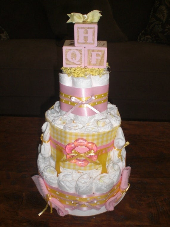 yellow and pink diaper cake baby shower centerpiece other toppers and